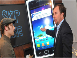 eBay CEO will run PayPal in interim